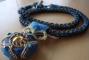 Nefertiti's Treasure Ceramic Blue Cosmic Ring and Brandy Rivoli by Melanie de Miguel
