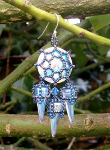 Swarovski rivolis trapped in filigree beadwork like tiny stained glass windows, with delicately beaded Czech spikes suspended below. These Tatiana Earrings are worked by modifying some components of the St Olave necklace. For this version I have used an 18mm Rivoli which gave me plenty of room for 3 spike beads!